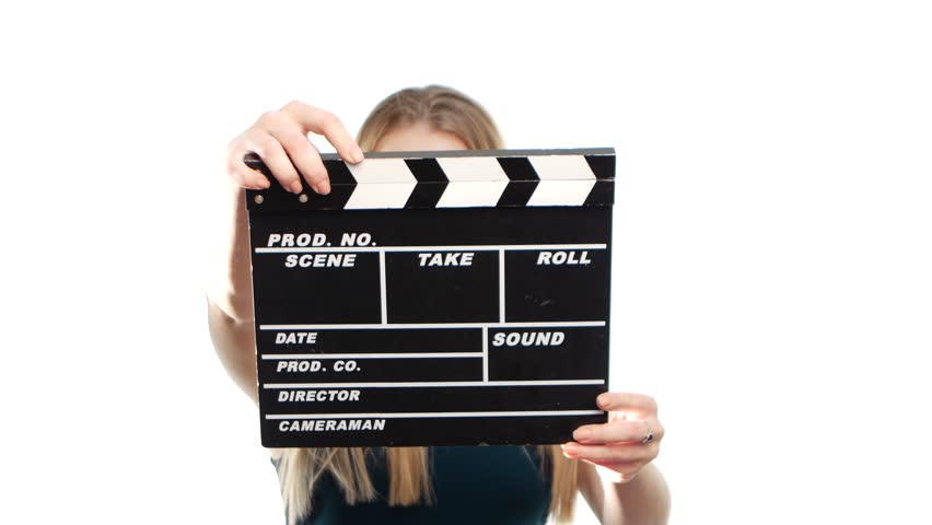 Elegant woman with sexy red lips holding clapper board and smiling, on white