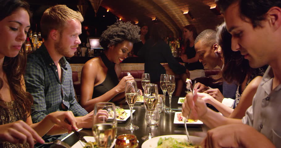 Group Of Friends Enjoying Meal In Restaurant Shot On R3D | Shutterstock HD Video #14882995
