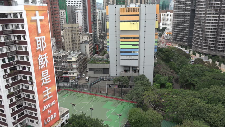 HONG KONG - 26 NOVEMBER 2015: A large banner advocates Christianity in a Kowloon neighborhood in Hong Kong | Shutterstock HD Video #14885335