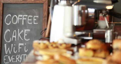 Displaying of bread and pastries on the counter at the coffee shop