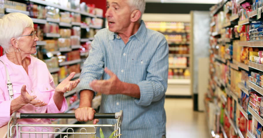 Senior couple arguing in the supermarket in high quality 4k format