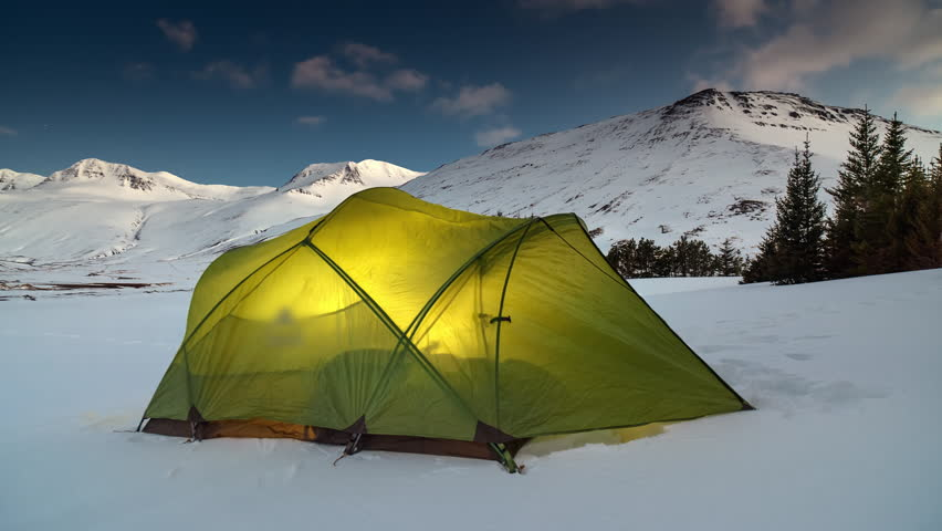 Timelapse of glowing lit tent c& c&site in snowy environment remote natural icy adventure - & Time Lapse Video Tent Against The Background Of The Mountains ...