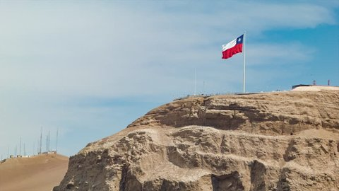 Arica Chile National Flag Waving Close-up on Top of a Dry Desert Mountain on a Sunny Summers Day in South America