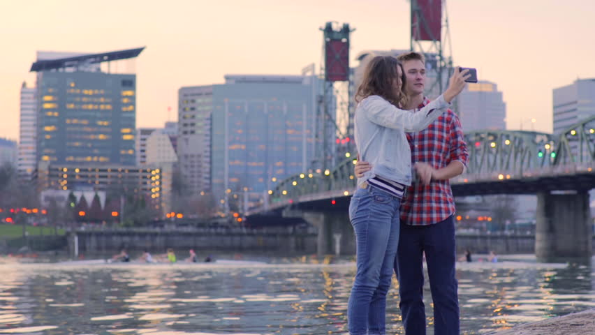 Fun Couple Stand On Dock To Take Selfies, Man Messes With His Girlfriend