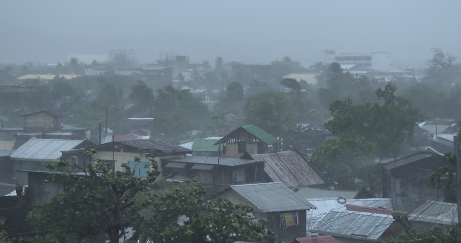 Hurricane Winds Lash City Heavy Rain. View overlooking a tropical city as a powerful hurricane hits. Originally shot in 4K