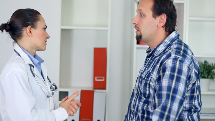 Female doctor telling bad news to male patient
