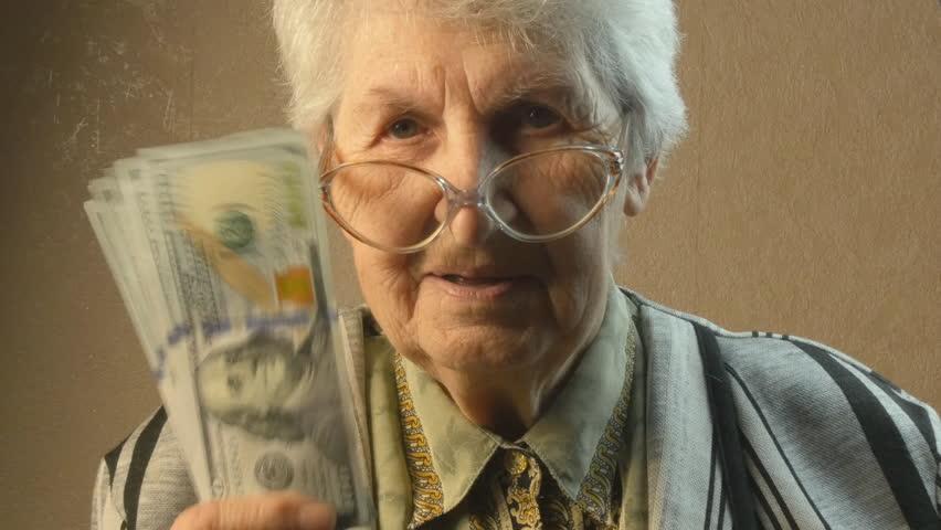 Old woman rejoices money | Shutterstock HD Video #15053785