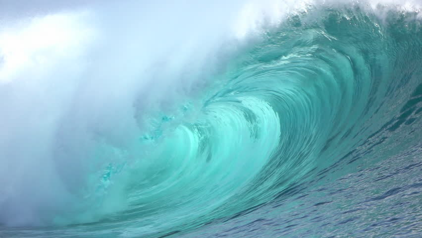 SLOW MOTION CLOSE UP: Big powerful Teahupoo tube wave breaking and splashing over the island reef, water drops spraying in the wind in sunny summer - HD stock video clip