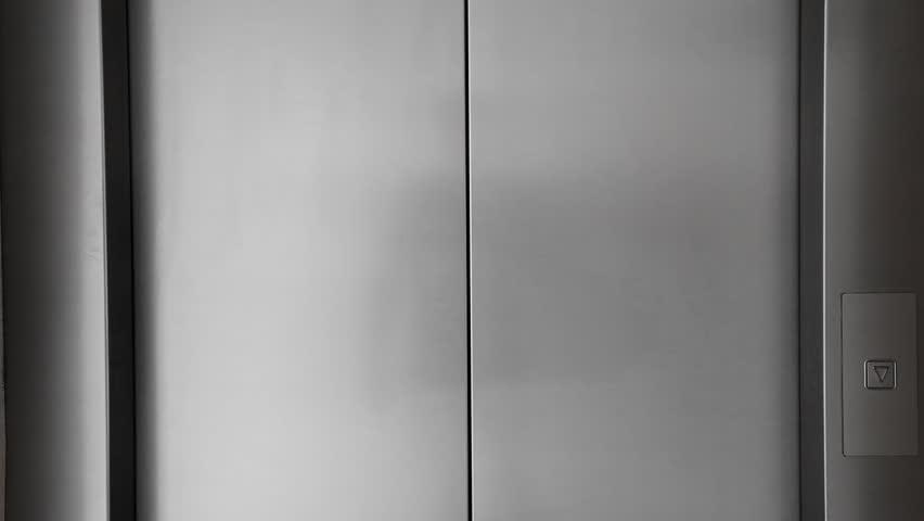 Man push button and Elevator doors open & Lift Doors Stock Footage Video | Shutterstock pezcame.com