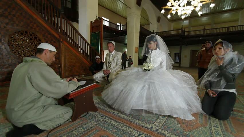 Imam (islamic priest) preaching at the Wedding Ceremony Nikah of Crimean Tatars in Mosque. Bakhchisaray Palace (Hansaray, Khan's Palace) Bakhchisaray, Crimea, Ukraine. lockdown, Wide Shot