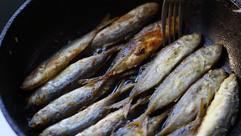 Fried fish. Jack Mackerels Frying In Hot Oil Pan
