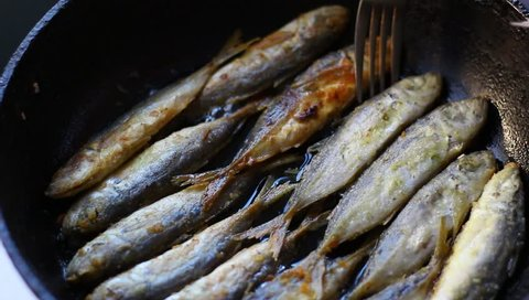 Fried fish. Jack Mackerels Frying In Hot Oil Pan