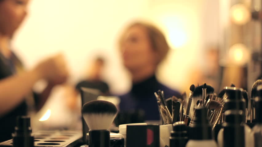 Professional makeup artist putting cosmetics.  Focus on the instrument.