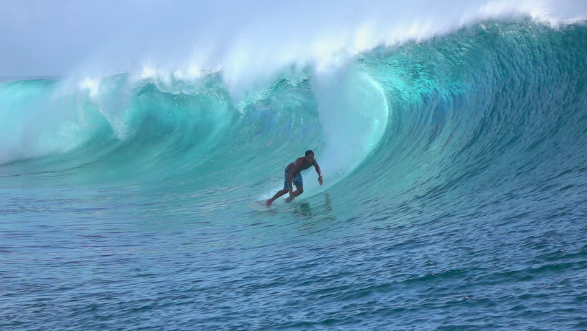 SLOW MOTION: Cheerful extreme pro surfer surfing big tube barrel wave Teahupoo in crystal clear Pacific ocean in sunny Tahiti island #15148555