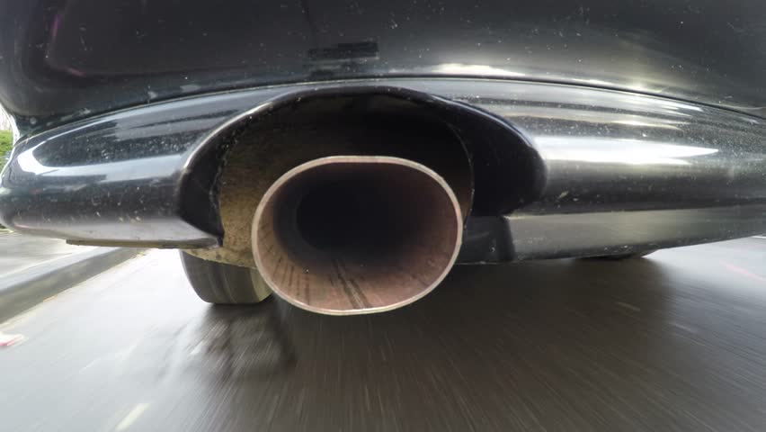 Car with pollution of the exhaust pipe. On-board-camera at a car in the fume of the exhaust pipe