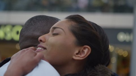 4k Attractive ethnic couple in love, saying goodbye at train station