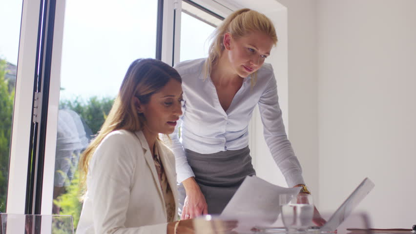 4K Attractive businesswomen working together in light modern office | Shutterstock HD Video #15216895