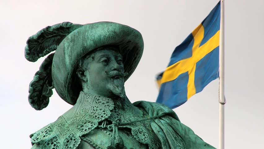 GOTHENBURG, SWEDEN - JUNE 27, 2013: Exterior detail of the monument to Swedish king Gustav II Adolf with the Swedish National flag at the background in Gothenburg, Sweden.