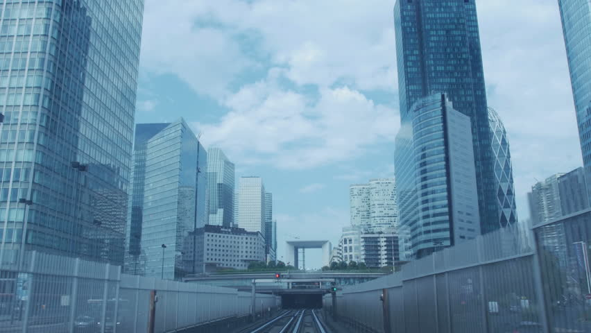 Train heading to La Grand Arch de La Defense, a major business district of Paris, France. Metro perspective.