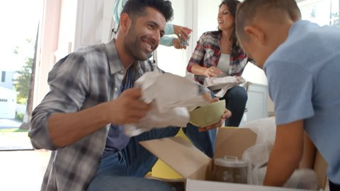 Slow Motion Shot Of Hispanic Family Moving Into New Home