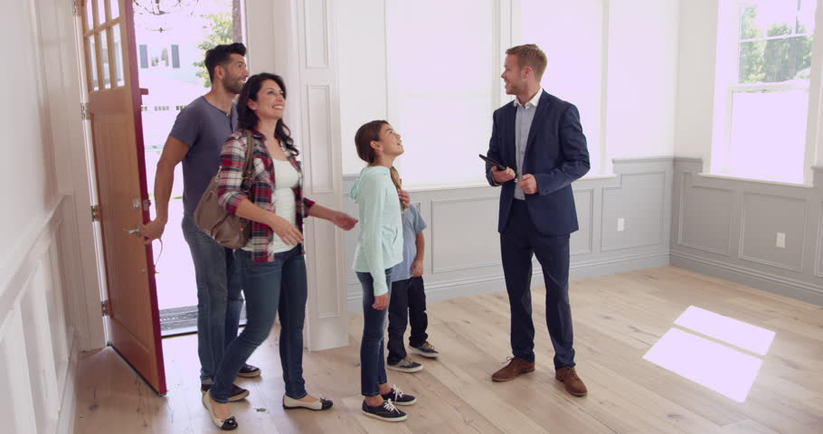 Realtor Showing Family Around New Home Shot On RED Camera