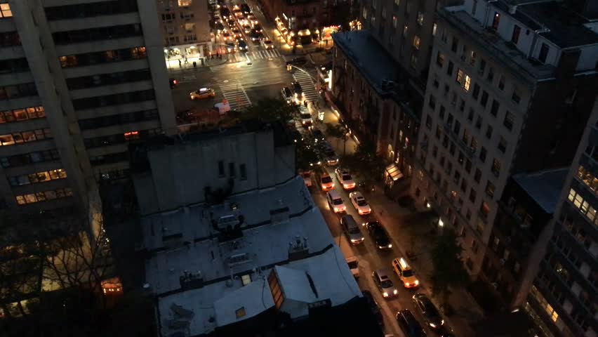 New York City – Manhattan skyline from rooftop at sunset with traffic. | Shutterstock HD Video #15313315