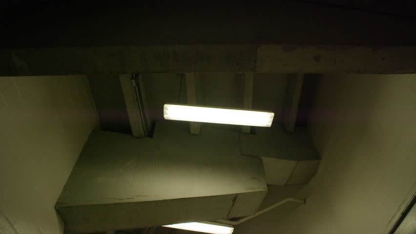 Slow motion tracking shot looking up at lights in a stadium tunnel / Pittsburgh, Pennsylvania - USA., August, 2014 #15345061