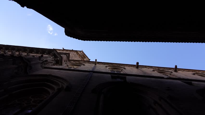 Gothic Cathedral Outside Wall Narrow Passage Against Blue Sky Slide Shot Camera Look Vertical