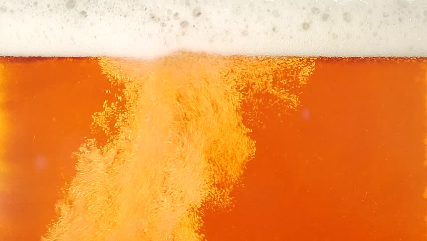 Pouring Beer. Closeup. Slow motion
