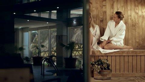 Three girlfriends steamed in a wooden sauna