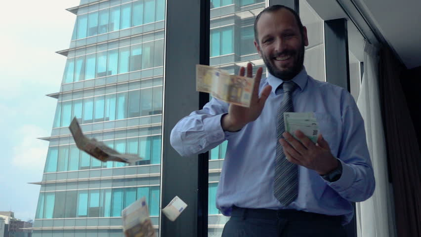 Successful, happy businessman throwing money, super slow motion 240fps