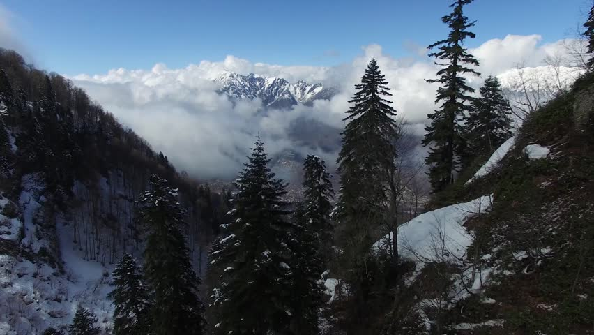 flight over the snow mountain in Sochi