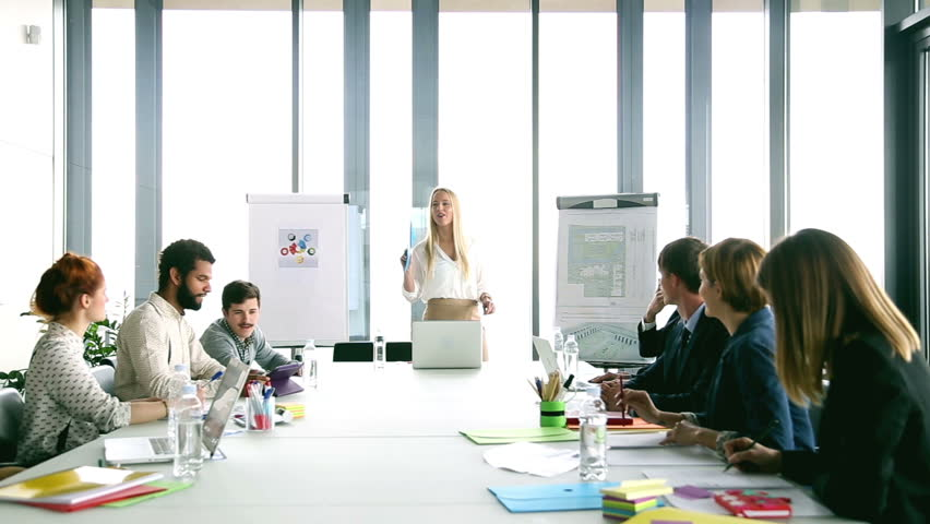 Beautiful young businesswoman on a meeting with colleagues, graded | Shutterstock HD Video #15414895