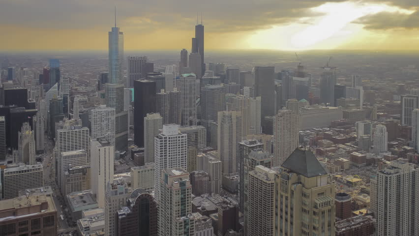 Afernoon Sun Rays Peek Through Clouds over Early Spring Evening Chicago Skyline Wide Angle Timelapse 4K UHD Ultra High Definition