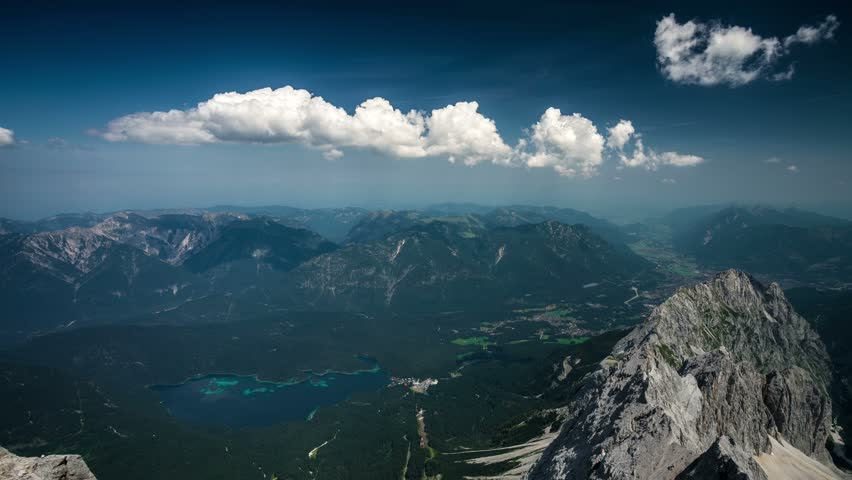 View from the Zugspitze peak on Garmisch-Partenkirchen and Eibsee 4k time-lapse #15461245