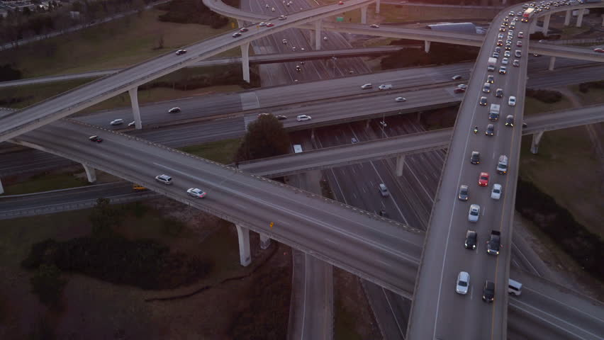 Atlanta Aerial v221 Flying low over Spaghetti Junction freeways panning up with cityscape sunset views.