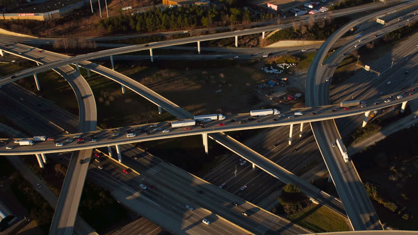 Atlanta Aerial v210 Flying over Spaghetti Junction freeways panning at sunset.