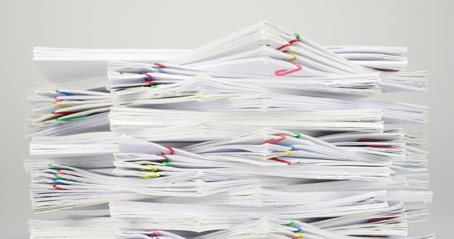 Stack overload document of report and receipt with colorful paperclip place on white table time lapse. Pile of document is decreasing as work is going to be successful. Business concept footage. | Shutterstock HD Video #15492109