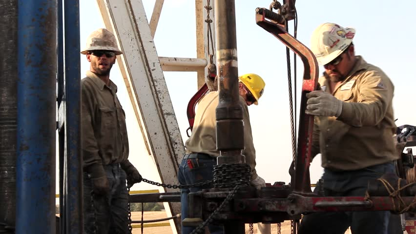 Drilling Rig Crew Changing out Drill String Close up / Texas - May, 2014