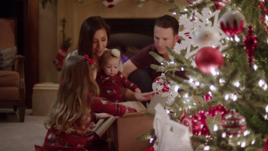 Medium shot of family opening Christmas presents / Cedar Hills, Utah, United States