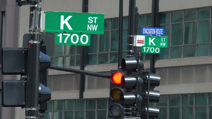 WASHINGTON, DC - MARCH 2016: K Street signs at Farragut Square, indicating legendary home to lobbyists and politics, although is now now mostly symbolic.
