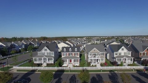 An aerial establishing video of a suburban neighborhood, 4K UHD