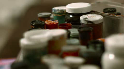 Jars of Paint in the Artist's Studio, There Are a Number Other Tubes of Paint, Blue Paint, Red Paint, Yellow Paint Brush in Paint Cans, Brushes Mixed Paint, Painting, Artist Tools, Transfer Focus