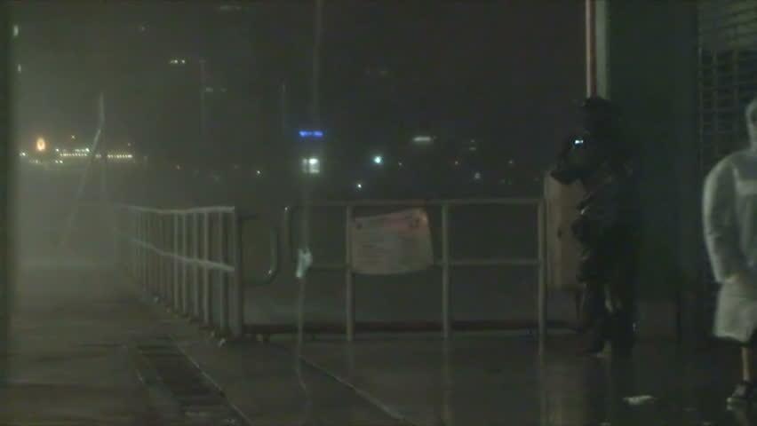 HONG KONG, CHINA - SEPTEMBER 2009: Hurricane Waves And Wind Lash Man | Shutterstock HD Video #15553375
