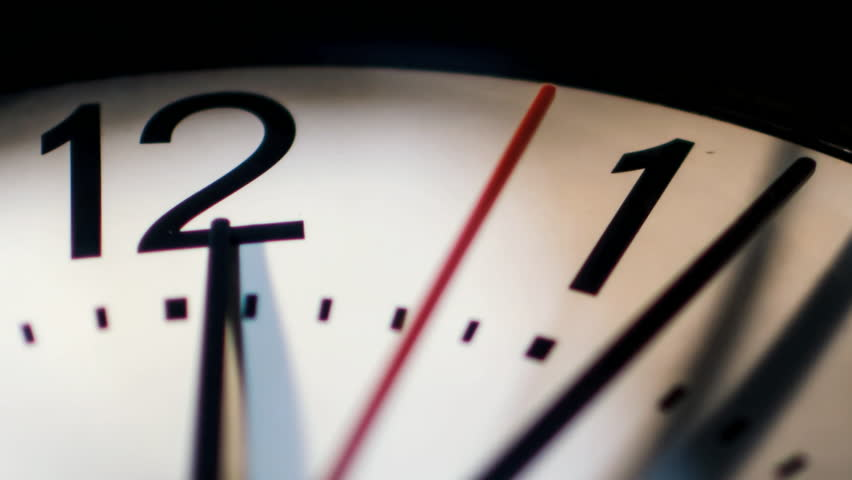 Time passing on classic wall clock face closeup  | Shutterstock HD Video #15588139
