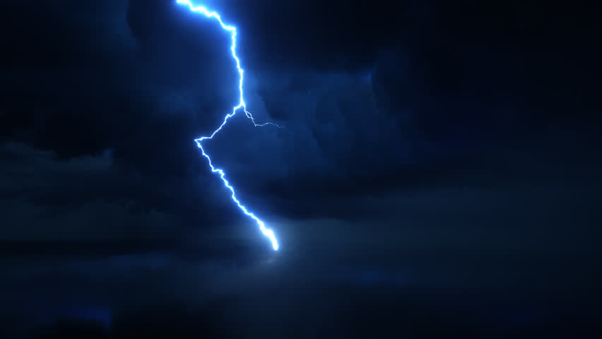 Thunderstorm with high quality lightning discharge in super slow motion against dark stormy sky with huge clouds. Ultra high speed camera shot. Perfect for film, documentary, digital composition