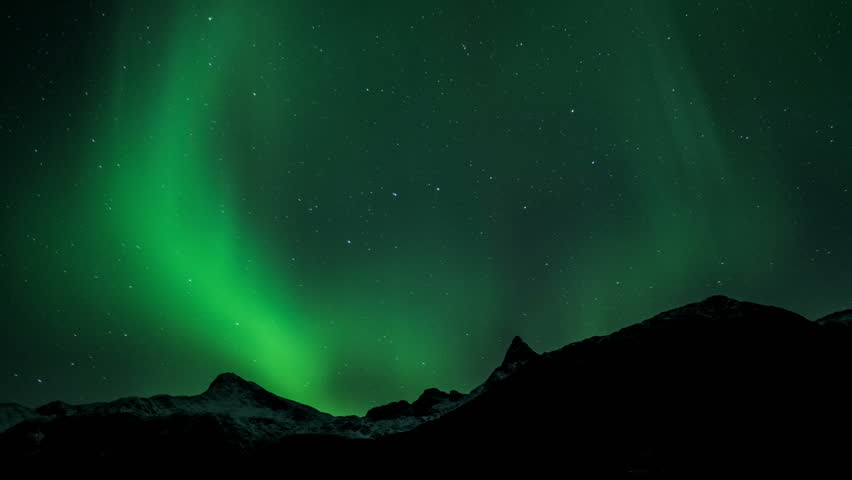 Northern light (aurora borealis) over a snowy mountain 4K | Shutterstock HD Video #15667915