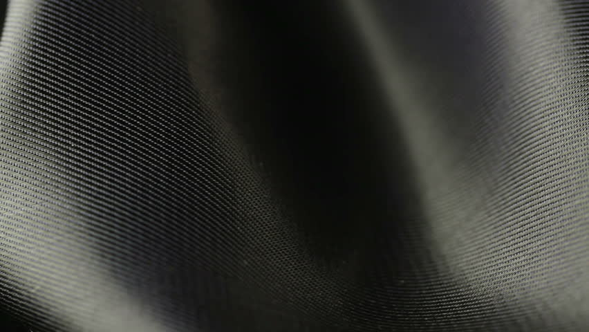background of black satin fabric closeup