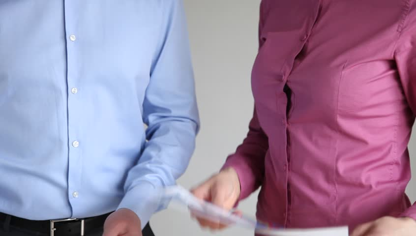 Business people discussing a new business project, gray background | Shutterstock HD Video #15730945