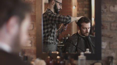 Male blowdry hair in barbershop